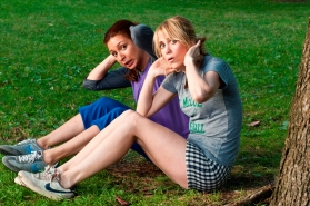 (L to R) Lillian (MAYA RUDOLPH) and Annie (KRISTEN WIIG) sneak in a workout in ?Bridesmaids?. In the comedy, Wiig stars as a maid of honor whose life unravels as she leads her best friend (Rudolph) and a group of colorful bridesmaids on a wild ride down the road to matrimony.