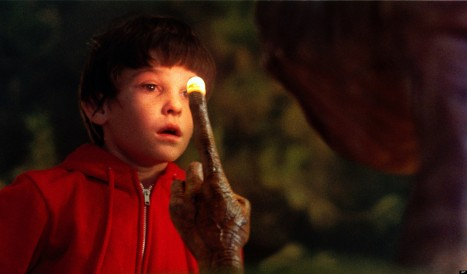 "This undated publicity film image released by Universal Pictures shows Henry Thomas as Elliott and E.T. in a scene from director Steven Spielberg's ""E.T.: The Extra-Terrestrial."" In honor of the 30th anniversary of ""E.T.,"" a digitally remastered feature film returns to theaters Oct. 3, 2012, along with a Blu-ray Anniversary Edition available Oct. 9. (AP Photo/Universal Pictures)"
