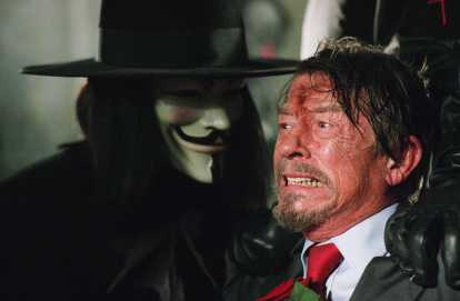 HUGO WEAVING as V and JOHN HURT as Adam Sutler in Warner Bros. PicturesÕ and Virtual StudiosÕ action thriller ÒV for Vendetta,Ó distributed by Warner Bros. Pictures. The film stars Natalie Portman. PHOTOGRAPHS TO BE USED SOLELY FOR ADVERTISING, PROMOTION, PUBLICITY OR REVIEWS OF THIS SPECIFIC MOTION PICTURE AND TO REMAIN THE PROPERTY OF THE STUDIO. NOT FOR SALE OR REDISTRIBUTION.
