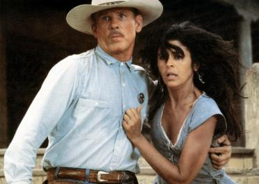 EXTREME PREJUDICE, from left: Nick Nolte, Maria Conchita Alonso, 1987. ©TriStar Pictures