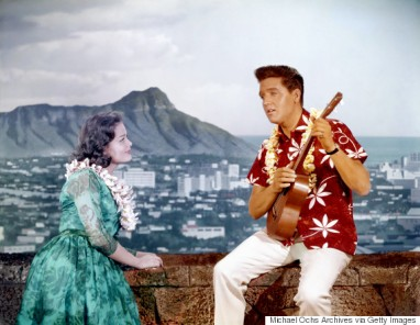 LOS ANGELES - APRIL 1964: Rock and roll singer and actor Elvis Presley in a movie still with a woman on the set of 'Blue Hawaii' at Paramount Pictures in April of 1961 in Los Angeles, California. (Photo by Michael Ochs Archives/Getty Images)