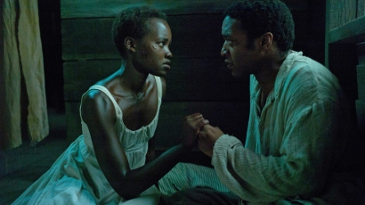 Lupita Nyong'o and Chiwetel Ejiofor play Patsey and Solomon, two slaves on a Louisiana plantation, in 12 Years a Slave.