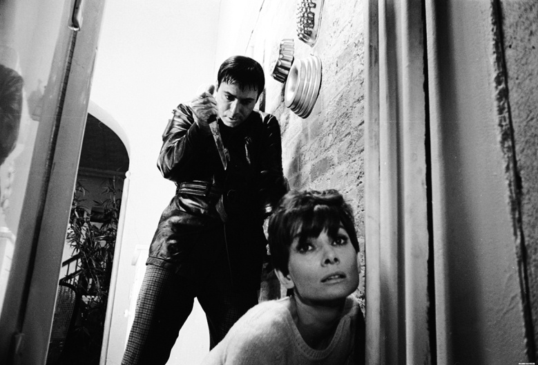 UNSPECIFIED - FEBRUARY 25: Medium shot of Alan Arkin as Roat, holding knife, standing behind crouching Audrey Hepburn as Susy Hendrix. (Photo by Warner Bros./Getty Images)