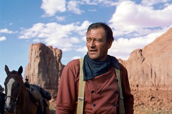 """ORG XMIT: *S0423530747* **FILE**In this photo released by Warner Bros., actor John Wayne plays Ethan Edwards in the 1956 film """"The Searchers."""" The film is among the American Film Institute's best western movies. (AP Photo/Warner Bros.) NY134 10292010xGUIDEDAILY"""