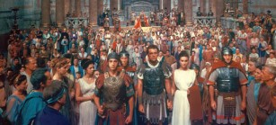 The Robe (1953) Directed by Henry Koster Shown in center foreground: Richard Burton, Jean Simmons. center, background: Jay Robinson