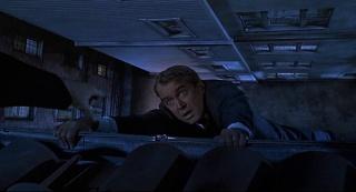 vertigo-movie-jimmy-stewart-hanging-on-rooftop-scottie
