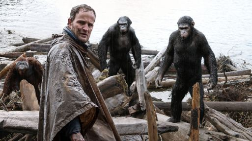 "EMBARGOED FROM ONLINE FOR 3:01 AM EDT Malcolm (Jason Clarke) is followed by Caesar (Andy Serkis), Koba (Toby Kebbell) and Maurice (Karin Konoval) as he tries to make peace with them in a scene from the motion picture ""Dawn of the Planet of the Apes."" CREDIT: WETA/20th Century Fox [Via MerlinFTP Drop]"